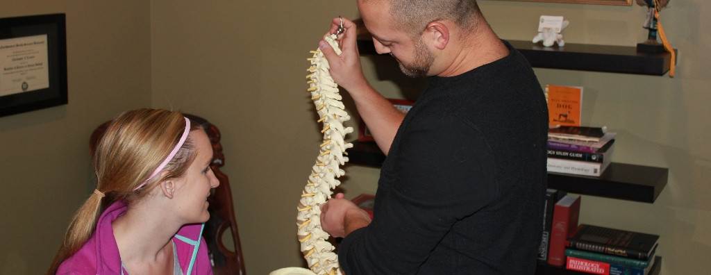 Dr. Trimner explaining the spine to a client